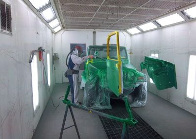 Jeep being painted green in our paint room